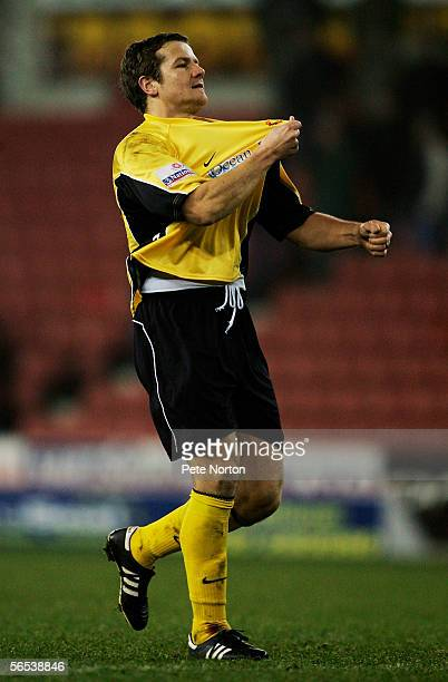 Mark Cooper the Tamworth player coach celebrates at the end of the FA Cup third round match between Stoke City and Tamworth at Britannia Stadium on...