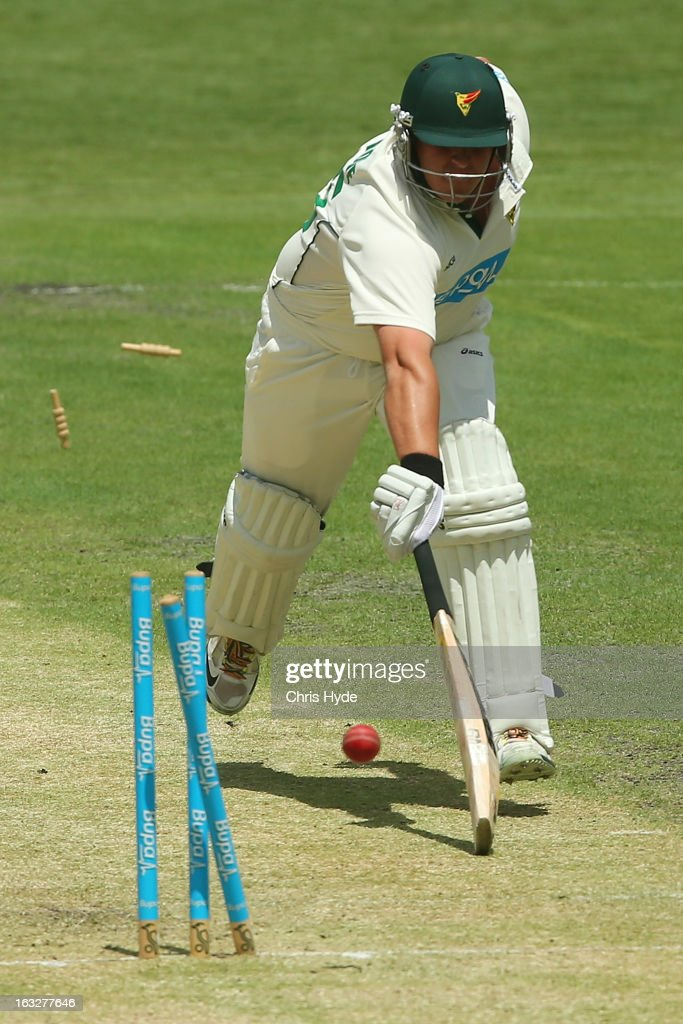 Mark Cosgrove of the Tigers is run out by Greg Moller of the Bulls during day one of the Sheffield Shield match between the Queensland Bulls and the Tasmanian Tigers at The Gabba on March 7, 2013 in Brisbane, Australia.