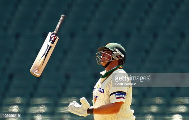 Mark Cosgrove of the Tigers throws his bat in the air while batting during day one of the Sheffield Shield match between the Victorian Bushrangers...