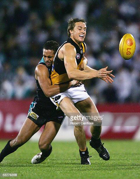 Mark Coughlan of the Tigers is tackled during the round 17 AFL match between the Port Adelaide Power and the Richmond Tigers at AAMI Stadium on July...
