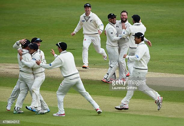 Mark Craig and Tom Latham of New Zealand are moobed after taking the wicket of Joe Root of England during day five of the 2nd Investec Test Match...
