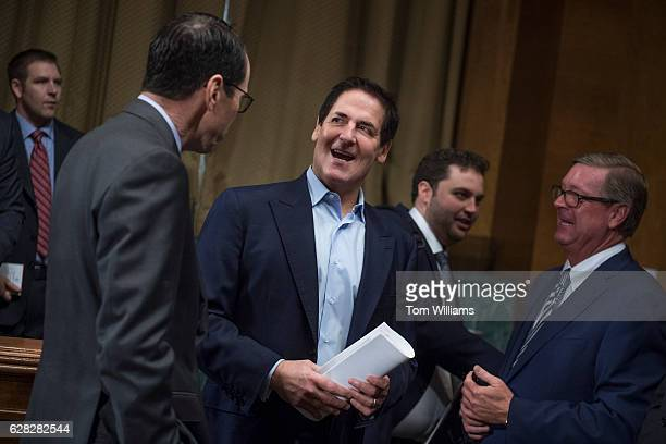 Mark Cuban center Chairman of AXS TV talks with Randall Stephenson left CEO of ATT before a Senate Judiciary Subcommittee on Antitrust Competition...