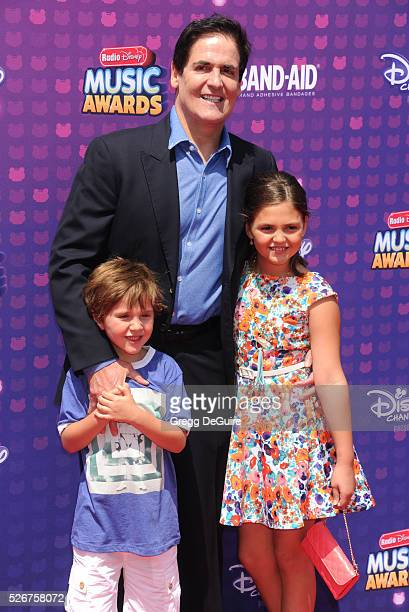 Mark Cuban kids Jake Cuban and Alyssa Cuban arrive at the 2016 Radio Disney Music Awards at Microsoft Theater on April 30 2016 in Los Angeles...