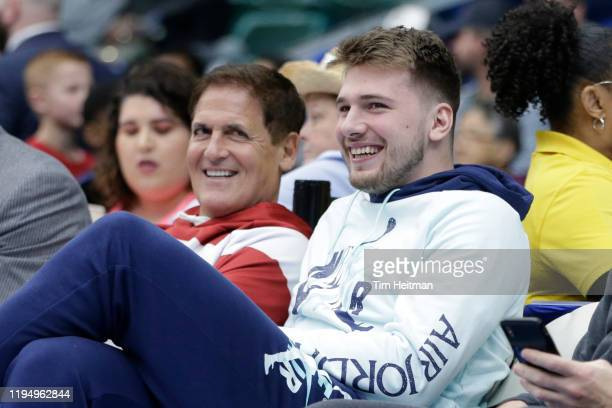 Mark Cuban owner of the Dallas Mavericks and Luka Doni of the Dallas Mavericks watch the game between the Texas Legends and the Salt Lake City Stars...