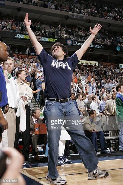 Mark Cuban owner of the Dallas Mavericks celebrates against the Houston Rockets during Game seven of the Western Conference Quarterfinals during the...