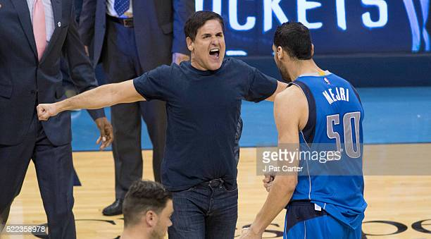 Mark Cuban owner of the Dallas Mavericks celebrates with Salah Mejri of the Dallas Mavericks after Game Two of the Western Conference Quarterfinals...