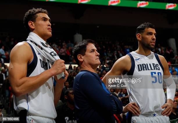 Mark Cuban owner of the Dallas Mavericks looks on with Dwight Powell and Salah Mejri in the final seconds of their 112107 loss to the Atlanta Hawks...