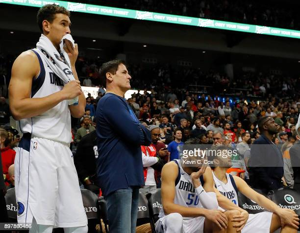 Mark Cuban owner of the Dallas Mavericks looks on with Dwight Powell Salah Mejri and Maximilian Kleber in the final seconds of their 112107 loss to...