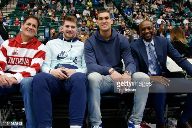 Mark Cuban owner of the Dallas Mavericks Luka Doni of the Dallas Mavericks Dwight Powell of the Dallas Mavericks and Jason Terry Assistant General...
