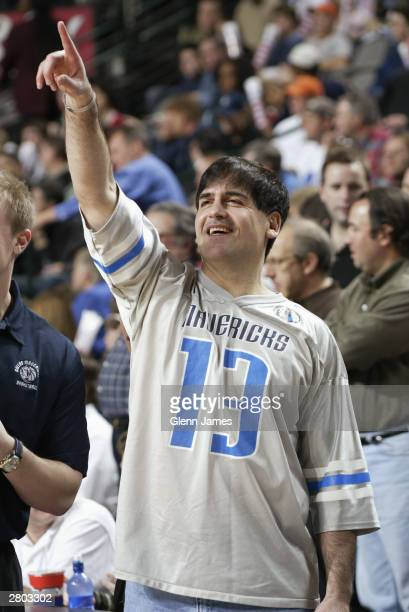 Mark Cuban owner of the Dallas Mavericks points up at the screen during the game against the Los Angeles Lakers at the American Airlines Center on...
