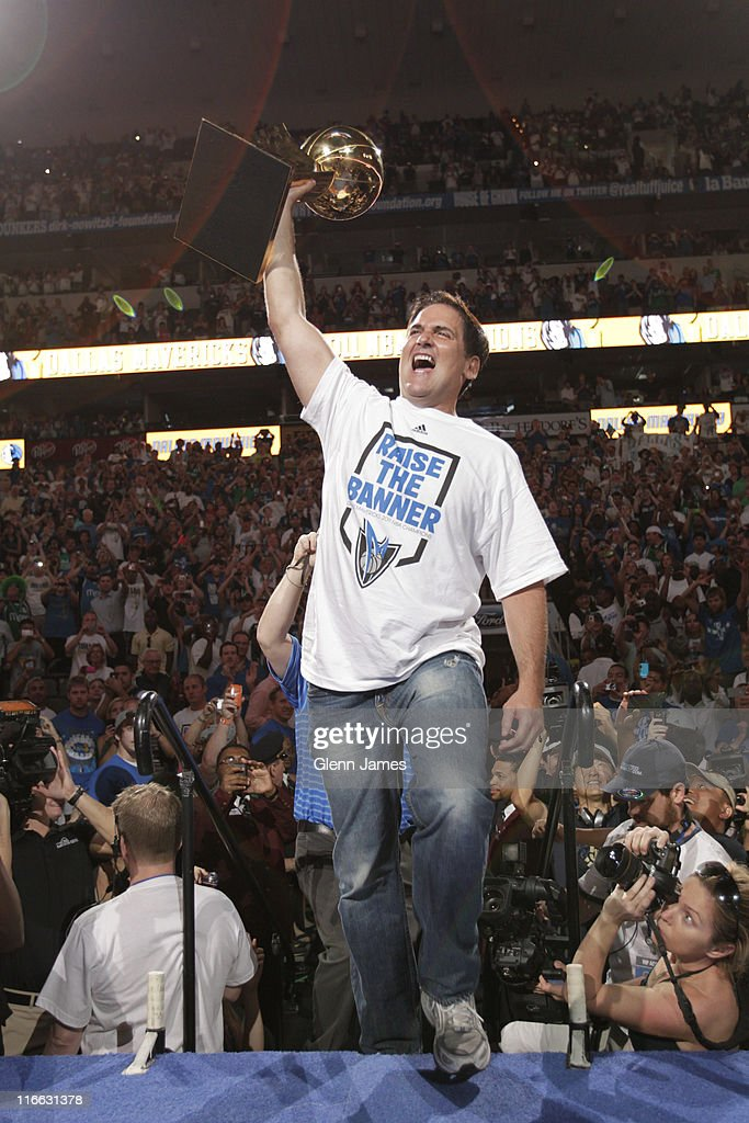 Mark Cuban, owner of the Dallas Mavericks shows off the Larry O'Brien trophy during the Mavericks NBA Champion Victory Parade on June 16, 2011 at the American Airlines Center in Dallas, Texas.