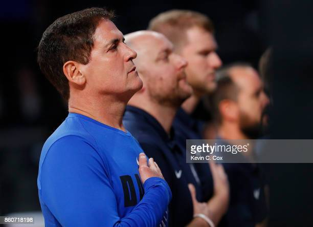 Mark Cuban owner of the Dallas Mavericks stands during the National Anthem prior to the game against the Atlanta Hawks at McCamish Pavilion on...