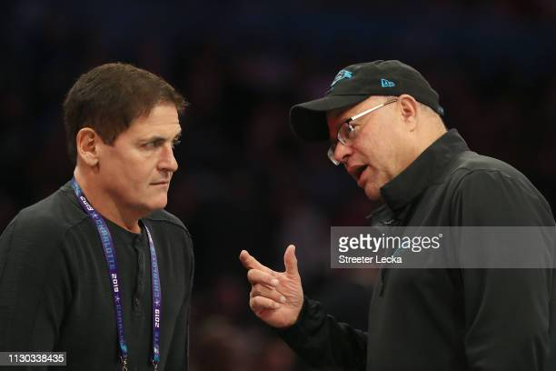 Mark Cuban owner of the Dallas Mavericks talks with David Tepper Panthers owner during the Taco Bell Skills Challenge as part of the 2019 NBA AllStar...