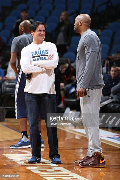 Mark Cuban owner of the Dallas Mavericks talks with Gary Trent of the Minnesota Timberwolves and April 3 2016 at Target Center in Minneapolis...