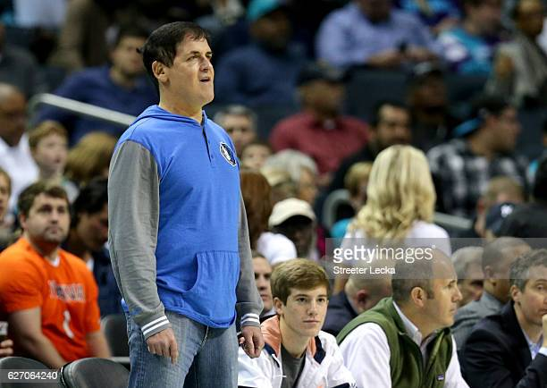 Mark Cuban owner of the Dallas Mavericks watches on during their game against the Charlotte Hornets at Spectrum Center on December 1 2016 in...