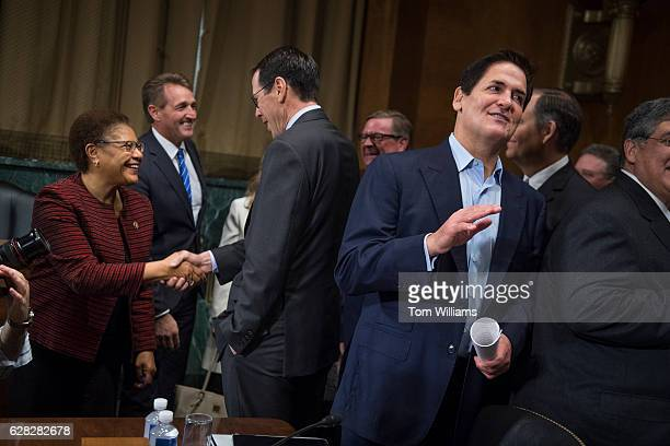 Mark Cuban right Chairman of AXS TV appears before a Senate Judiciary Subcommittee on Antitrust Competition Policy Consumer Rights hearing in Dirksen...