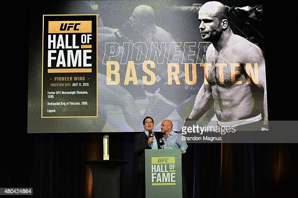Mark Cuban shares moments with Bas Rutten as he is inducted into the UFC Hall of Fame at the UFC Fan Expo in the Sands Expo and Convention Center on...