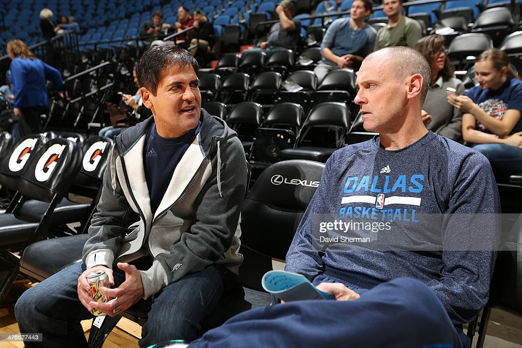 Mark Cuban talks to Rick Carlisle of the Dallas Mavericks before they play against the Minnesota Timberwolves on November 8, 2013 at Target Center in Minneapolis, Minnesota.