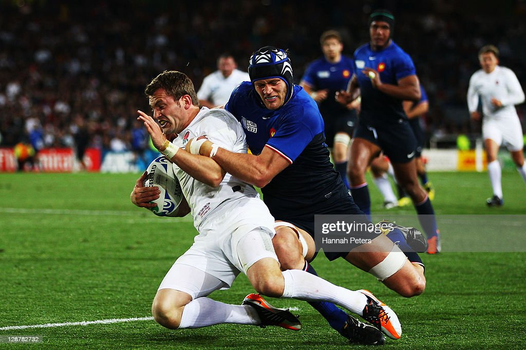 Mark Cueto of England is tackled by Julien Bonnaire of France during quarter final two of the 2011 IRB Rugby World Cup between England and France at Eden Park on October 8, 2011 in Auckland, New Zealand.