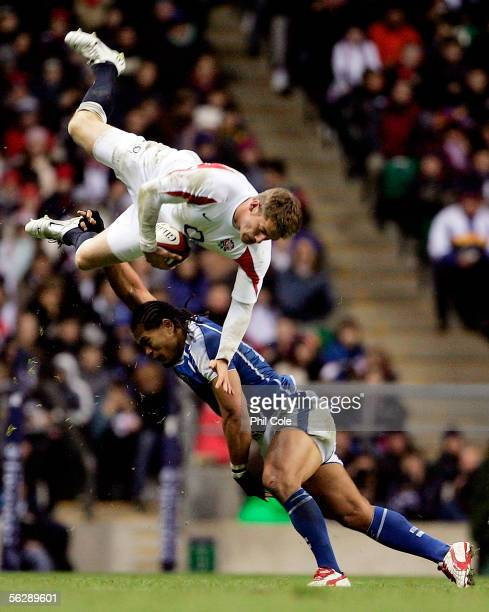 Mark Cueto of England is up ended by Alesana Tuilagi of Samoa which resulted in him being sent off during the Investec Challenge match between...