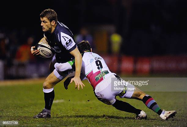 Mark Cueto of Sale Sharks takes on Danny Care of Harlequins during the Guinness Premiership Match between Sale Sharks and Harlequins at Edgeley Park...