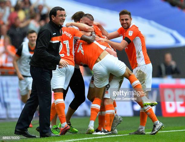 Mark Cullen of Blackpool celebrates as he scores their second goal with team mates and Gary Bowyer manager of Blackpool during the Sky Bet League Two...