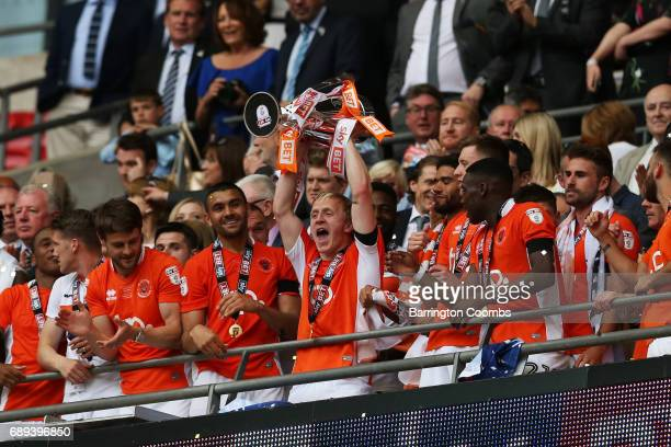 Mark Cullen of Blackpool celebrates victory and promotion with the trophy after the Sky Bet League Two Playoff Final between Blackpool and Exeter...