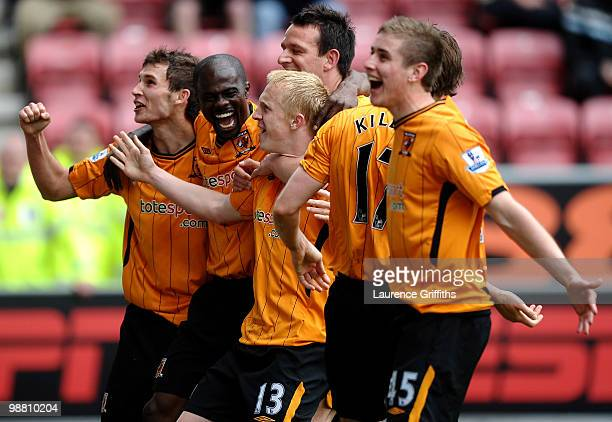 Mark Cullen of Hull City is mobbed after scoring the second goal during the Barclays Premier League match between Wigan Athletic and Hull City at JJB...