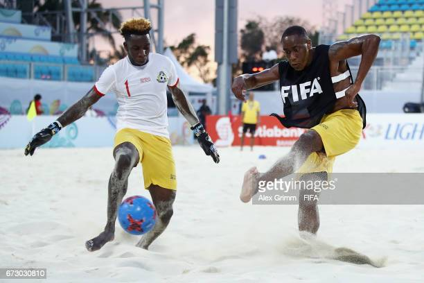 Mark Daniels is challenged by Julio Jemison during a Bahamas training session before the FIFA Beach Soccer World Cup Bahamas 2017 at National Beach...