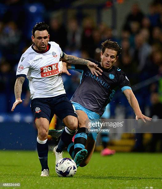 Mark Davies of Bolton is tackled by Sam Hutchinson of Sheffield Wednesday during the Sky Bet Championship match between Bolton Wanderers and...