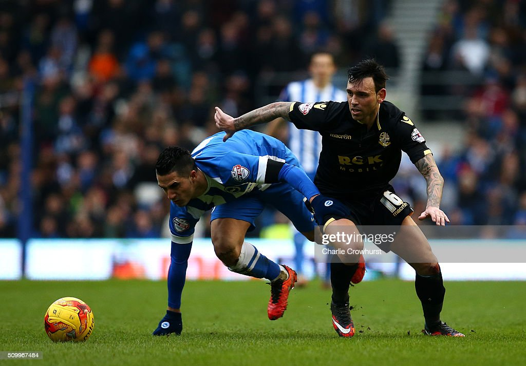 Mark Davies of Bolton (R) looks to beat Brighton's Beram Kayal to the ball during the Sky Bet Championship match between Brighton and Hove Albion and Bolton Wanderers at The Amex Stadium on February 13, 2016 in Brighton, England.