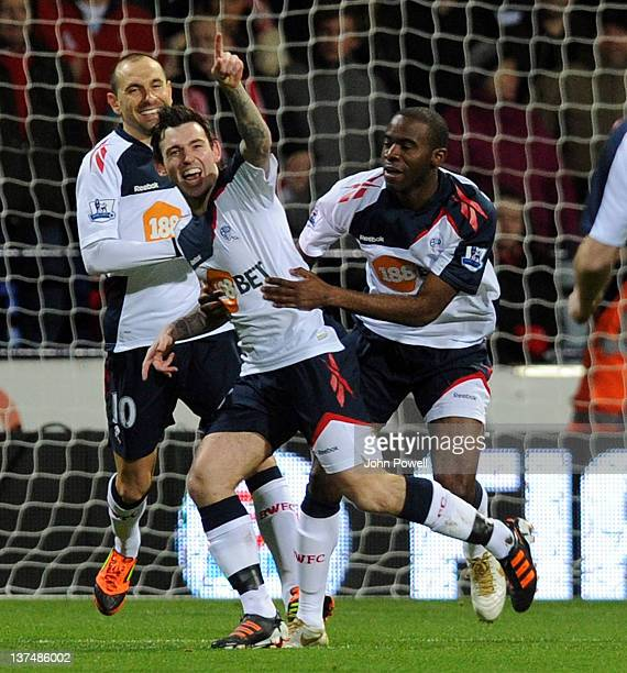 Mark Davies of Bolton Wanderers celebrates after scoring the opening goal of the Barclays Premier League match between Bolton Wanderers and Liverpool...