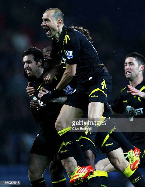 Mark Davies of Bolton Wanderers celebrates with his team mates after scoring the opening goal during the Barclays Premier League match between...