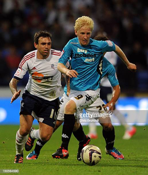 Mark Davies of Bolton Wanderers chases Will Hughes of Derby County during the npower Championship match between Bolton Wanderers and Derby County at...