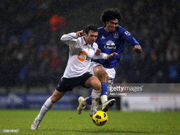 Mark Davies of Bolton Wanderers competes with Marouane Fellaini of Everton during the Barclays Premier League match between Bolton Wanderers and...