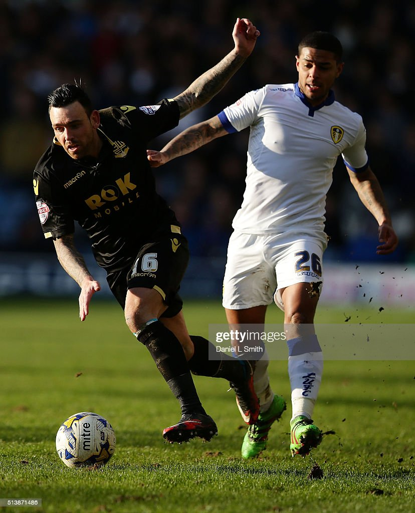 Mark Davies of Bolton Wanderers FC under pressure from Charlie Taylor of Leeds United FC during the Sky Bet Championship League match between Leeds United and Bolton Wanderers, at Elland Road Stadium on March 5, 2016 in Leeds, United Kingdom.