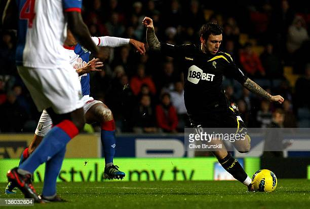 Mark Davies of Bolton Wanderers scores the opening goal during the Barclays Premier League match between Blackburn Rovers and Bolton Wanderers at...
