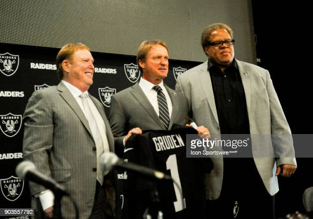 Mark Davis and Reggie McKenzie on both sides of Jon Gruden after the Jon Gruden Press Conference on January 9 2017 at Raiders Headquarters in Alameda...