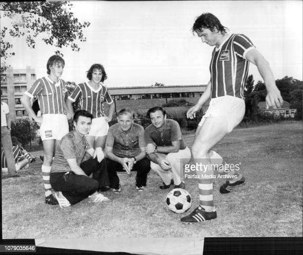Mark Davis of Bankstown Boys high gets a kick away under the watchful eyes of Czech team members left to Right Dr Gyorgy Szilagyi Jim Starosta and Dr...