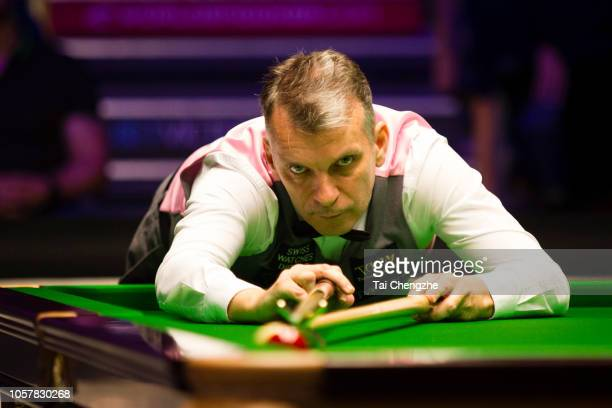 Mark Davis of England plays a shot during the final match against Stuart Bingham of England on day seven of the 2018 BetVictor English Open at K2...