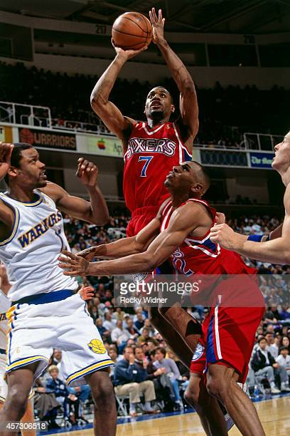 Mark Davis of the Philadelphia 76ers shoots against the Golden State Warriors on January 3 1997 at the Arena in Oakland in Oakland California NOTE TO...