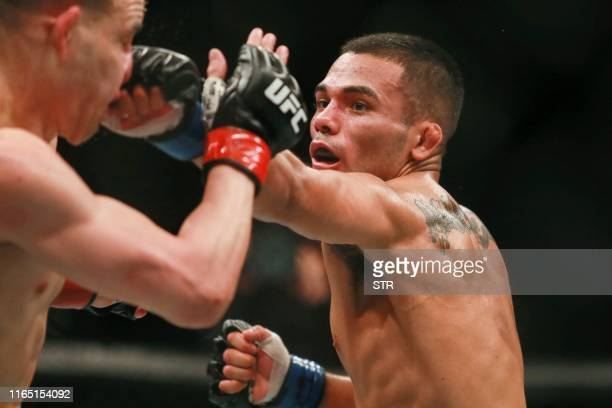 Mark De La Rosa of the US fights against Kai KaraFrance of New Zealand during the UFC Fight Night in Shenzhen in China's southern Guangdong province...