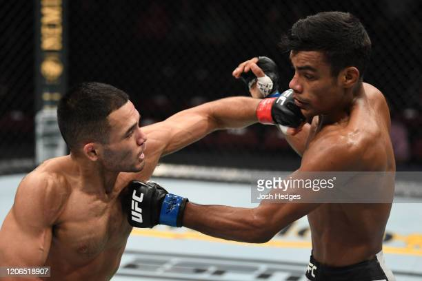 Mark De La Rosa punches Raulian Paiva of Brazil in their flyweight bout during the UFC Fight Night event at Santa Ana Star Center on February 15,...