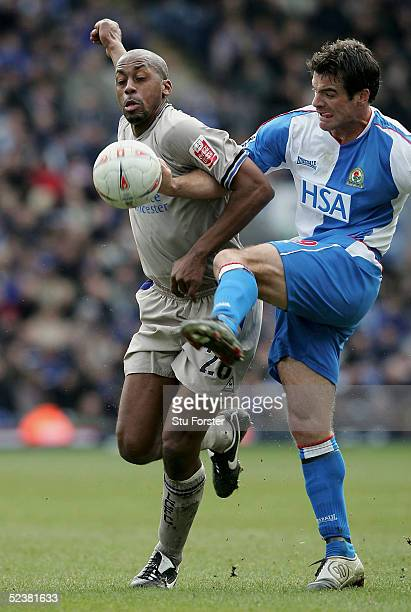 Mark De Vries of Leicester City is challenged by Ryan Nelsen of Blackburn during the 6th Round FA Cup match between Blackburn Rovers and Leicester...