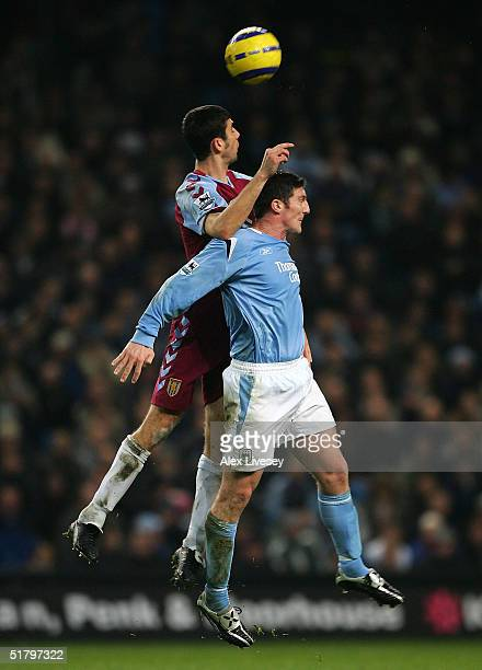 Mark Delaney of Aston Villa beats Jon Macken of Manchester City to a header during the Barclays Premiership match between Manchester City and Aston...