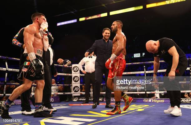 Mark DeLuca speaks to Kell Brook as Dominic Ingle Trainer of Kell Brook reacts after the WBO Intercontiental SuperWelterweight Title Fight between...