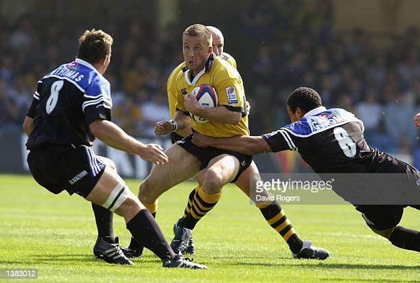 Mark Denney the Wasps centre takes on Nathan Thomas and Gavin Thomas of Bath during the Zurich Premiership match between Bath and London Wasps at The...