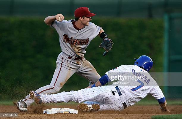 Mark DeRosa of the Chicago Cubs is forced out at secondbase by Stephen Drew of the Arizona Diamondbacks on a fielder's choice hit by Jacque Jones of...