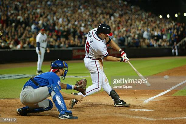 Mark DeRosa of the Atlanta Braves doubles and drives in two runs against the Chicago Cubs in the eighth inning of Game 2 of the National League...