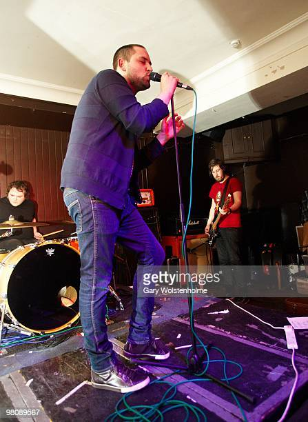 Mark Devine, James Graham and Johnny Docherty of The Twilight Sad performs on stage at The Harley on March 27, 2010 in Sheffield, England.
